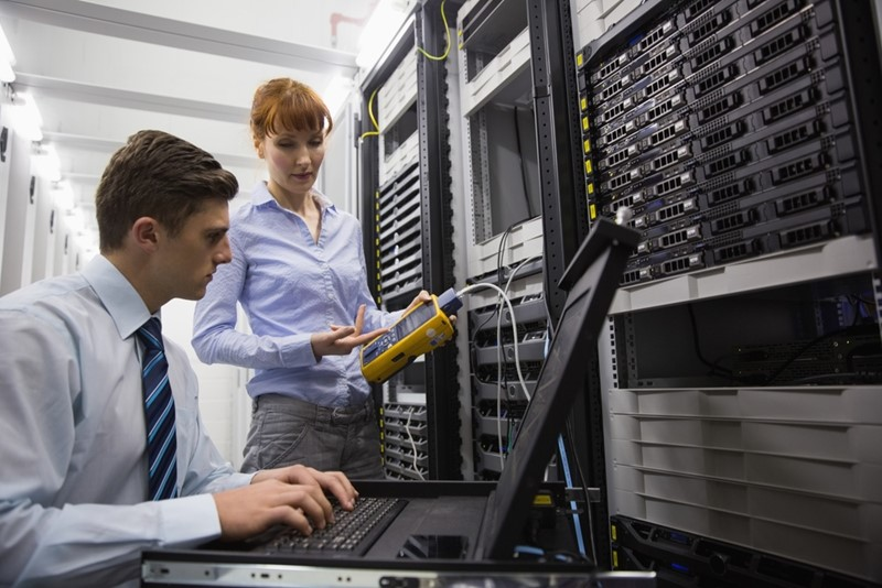 Professionally dressed coworkers working on a data center.