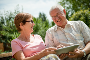 Older man and women using tablet